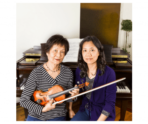 violin teacher with student